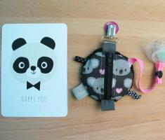 range-tétine noir et pandas