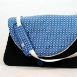 sac à langer marron et bulles bleu
